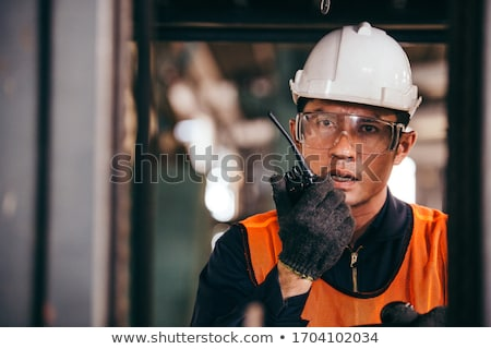 Construction worker speaking into a walkie-talkie Stock photo © photography33