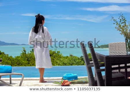 attractive couple in bathrobes on the beach stock photo © photography33