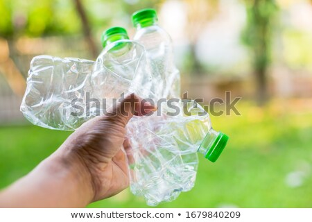 Man with empty bottles and containers stock photo © photography33
