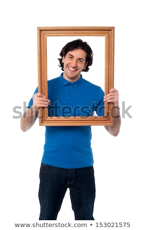 Man holding empty picture frame stock photo © photography33