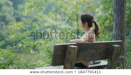 rear view of woman sitting stock photo © zzve