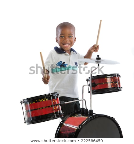 Close-up of boy playing with drum Stock photo © zzve