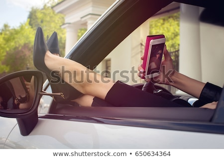 Woman legs in high heels out the windows in car  Stock photo © dashapetrenko