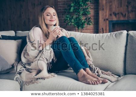 улыбающаяся · женщина · кофе · диван · подушкой · сидят · девушки - Сток-фото © feelphotoart