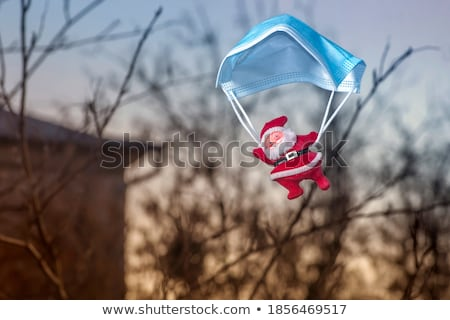 Santa Claus with parachute Stock photo © adrenalina