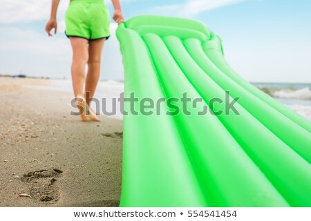 little boy on beach mattress stock photo © nyul