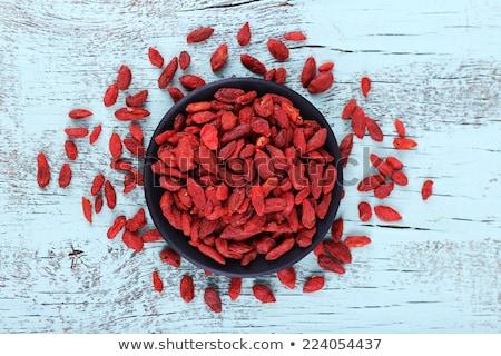 Tibetan goji berries (wolfberry) on black Stock photo © PixelsAway