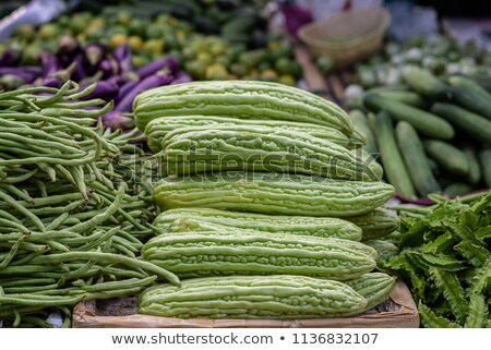 Pile of bitter melons on market  Stock photo © tang90246