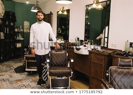 Stock photo: Confident hairdresser smiling at camera