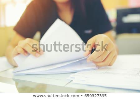 trabalhador · de · escritório · olhando · arquivos · escritório · papel · secretária - foto stock © nyul