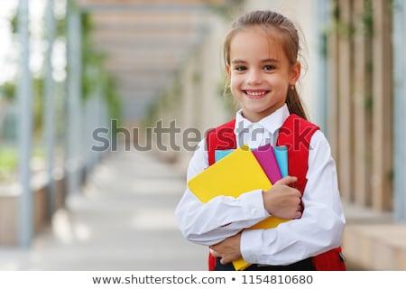 Portret mały uczennica stałego odizolowany biały Zdjęcia stock © deandrobot
