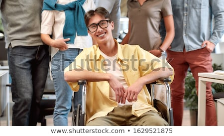 Businessman with his co-workers in office smiling, looking at ca Stock photo © zurijeta