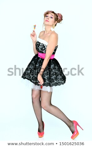 full length portrait of a charming woman with lollipop stock photo © deandrobot