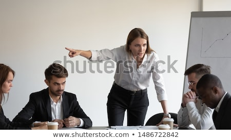 Stock photo: man threatens woman: harassments on the workplace