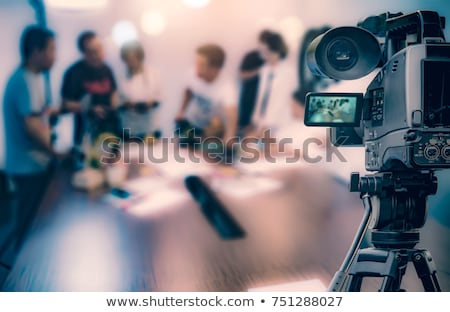 Filming an media event with a video camera Stock photo © wellphoto