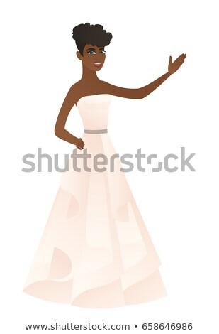African-american fiancee showing a direction. Stock photo © RAStudio