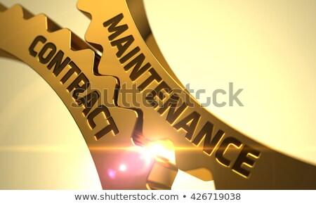 Manutenção contrato dourado engrenagens mecanismo Foto stock © tashatuvango
