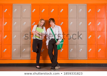 Full length of boy leaning on lockers in corridor at school Stock photo © wavebreak_media