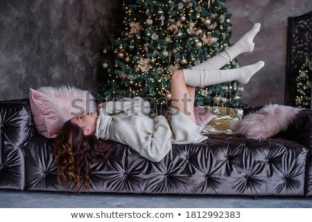 Csinos nő ül kandalló fa modell doboz Stock fotó © acidgrey