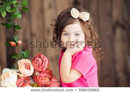 Kicsi aranyos imádnivaló mosolyog lány íj Stock fotó © Traimak