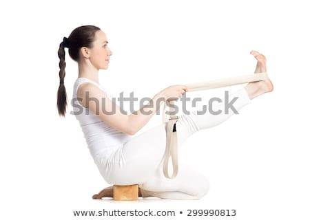 feliz · mulher · jovem · exercer · tapete · de · yoga · ginásio · esportes - foto stock © andreypopov