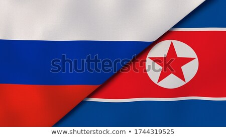 Two waving flags of Russia and North Korea Stock photo © MikhailMishchenko