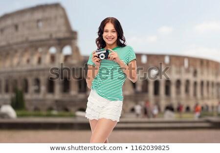 teenage girl with film camera over coliseum Stock photo © dolgachov