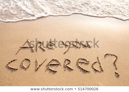 are you covered question on the beach stock photo © andreypopov