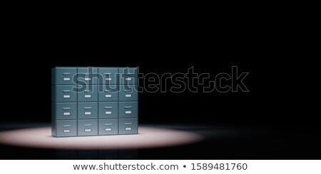 Archive Rack Spotlighted on Black Background Stock photo © make