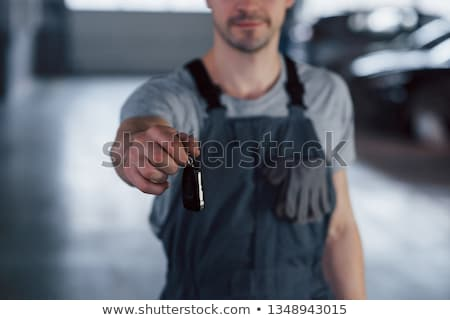 Mechanic giving a car key Stock photo © nomadsoul1