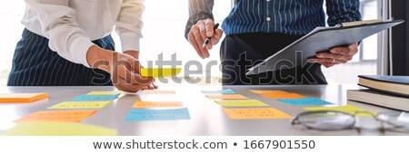 Businesswoman Arranging Sticky Notes Stock photo © AndreyPopov