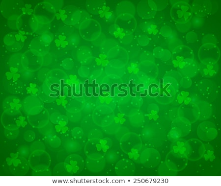 happy saint patricks day green glowing leaves background Stock photo © SArts