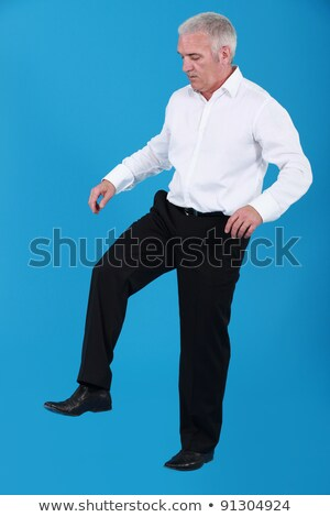 Man in stomping position Stock photo © photography33