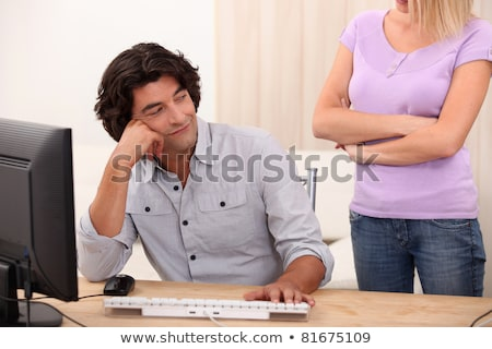 Woman peeved at her partner's computer use Stock photo © photography33