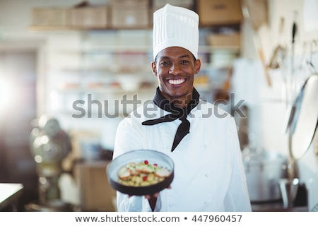 male chef presenting food Stock photo © dotshock