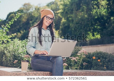 Working with a laptop in the park Stock photo © stryjek