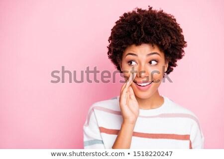 Genç kadın fısıldamak gizli portre yalıtılmış Stok fotoğraf © pablocalvog
