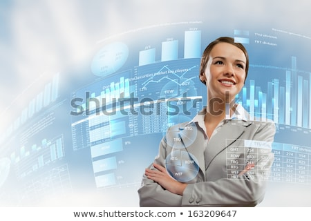 Attractive businesswoman against hightech background Stock photo © HASLOO
