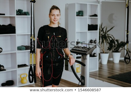 Training suit hanging on Modern Electro Muscular Stimulation EMS machine  Stock photo © Nejron