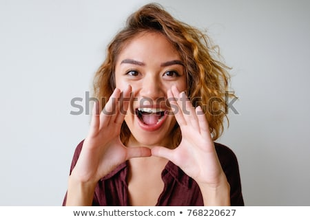 asian young woman shouting stock photo © bmonteny