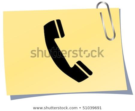 Phone handset icon on black glass button stock photo © aliaksandra