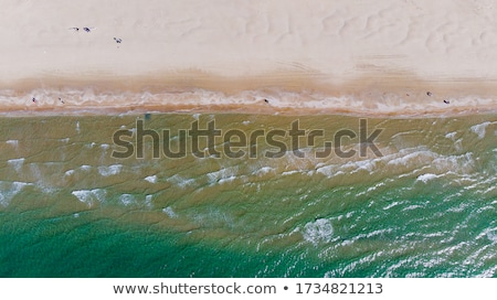Spiaggia di sabbia onde distanza spiaggia Ocean Foto d'archivio © backyardproductions