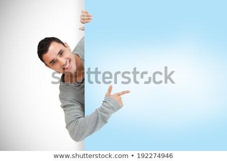 composite image of smiling handsome man pointing at billboard stock photo © wavebreak_media
