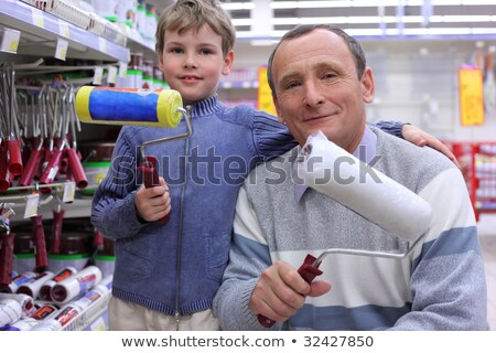 elderly man with  boy in shop with painting rollers in hands Stock photo © Paha_L