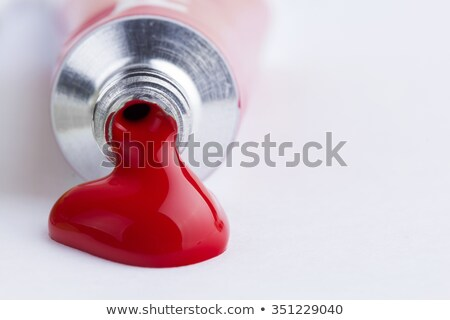 red paint spill stock photo © viperfzk
