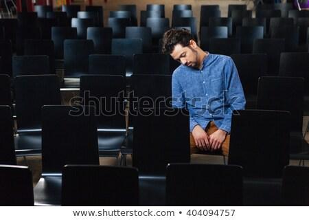 Bunalımlı adam oturma konferans salon gündelik Stok fotoğraf © deandrobot