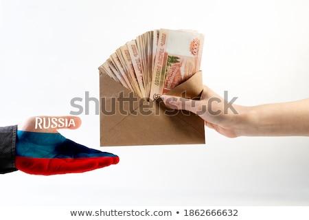 Business woman offering white envelope as bribe Stock photo © stevanovicigor