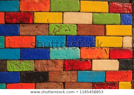 Stock fotó: Multicolored Painted Bricks Exterior Wall As Background