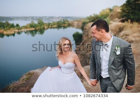 Hermosa jóvenes novia sonriendo rocas sesión Foto stock © Yatsenko