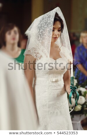 Portrait young bride with brunette hair in white wedding dress a Stock photo © dashapetrenko